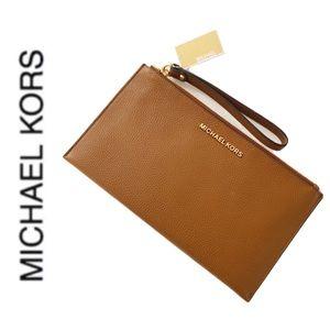 NWT authentic MK genuine leather wristlet acorn